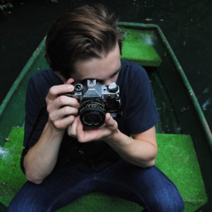 Fotograf im Kanu